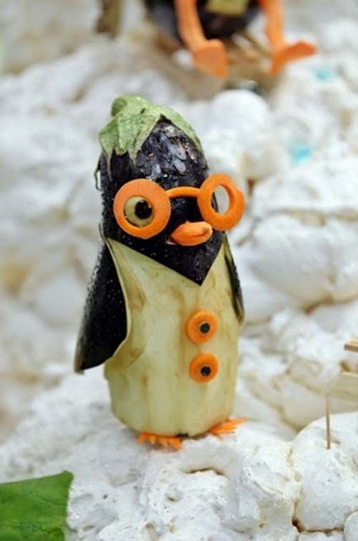 A penguin made from an aubergine and carrots is on display on September 5, 2011 during the first European vegetable carving competition in Germany