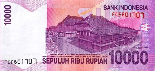 An Indonesian note for 1000 rupiah. The word rupiah derives from the Indian rupee. This note shows traditional houses in the city of Palembang