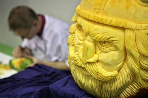 Czech vegetable carver Radek Vach sits behind his pumpkin work of a viking on September 5, 2011 during the first European vegetable carving competition in Germany