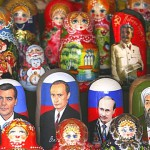 Portraits of Russian presidential candidate Dmitry Medvedev (C) and President Vladimir Putin (R) adorn traditional Russian nesting dolls, matryoshka