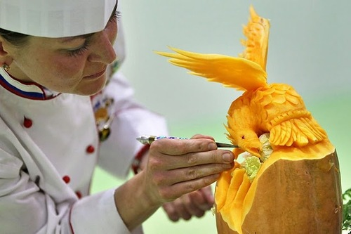 Russian vegetable carver Anastasia Korsakova makes finishing touches on her work on September 5, 2011 during the first European carving competition in Germany