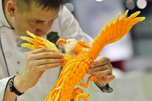 Russian vegetable carver Vadim Nefedjev makes finishing touches on his eagle work on September 5, 2011 during the first European carving competition in Germany