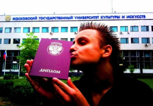 Freelance showman from the village of Churilovo Semyon Frolov kissing his Diploma