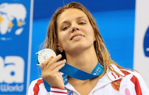 Russia's silver medalist Yuliya Yefimova holds her medal as she poses on the podium during the award ceremony for the final of the women's 50-metre breaststroke swimming event in the FINA World Championships at the indoor stadium of the Oriental Sports Center in Shanghai on July 31, 2011