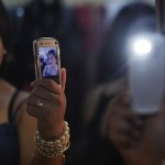 Participant of a Miss Large beauty pageant snaps a shot of herself with a mobile phone in the dressing room ahead of the contest in the Southern Israeli town of Beersheva