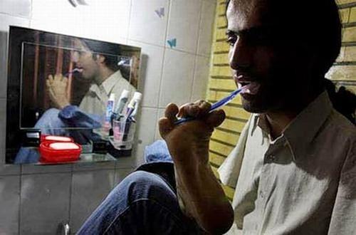 Ahmad is brushing his teeth