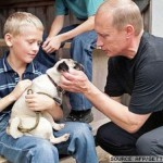 A boy with his puppy and Vladimir Putin
