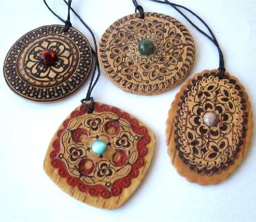 Birch bark pendants by Russian artist of applied art Vladimir Makhnyuk