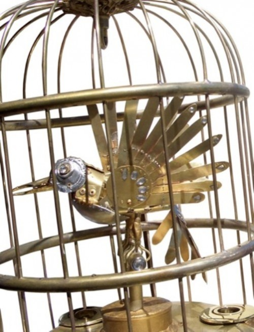 Bird in a cage created for Garsington Opera's production of Mozart's 'The Philosopher's Stone', Summer 2006. There is a motor in the base of the cage which activates the beak and tail