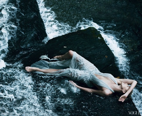 Charlize Theron in Salvatore Ferragamo silk-chiffon halter dress. Photographed by Annie Leibovitz