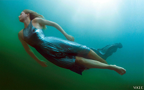 Charlize Theron swimming. Photographed by Annie Leibovitz