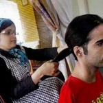 Wife Fatima is helping Ahmad to tie his hair