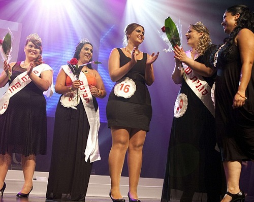 Miss Large Beauty winner, Vered Fisher, centre, stands on stage at the end of the Fat and Beautiful contest