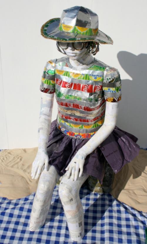 Seated figure sculpture