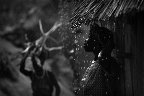 Sheltering from the rain in Dogon Country. Photo by English traveling photographer and filmmaker Timothy Allen