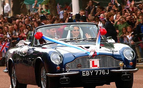 William and Kate delight the crowds with their getaway car