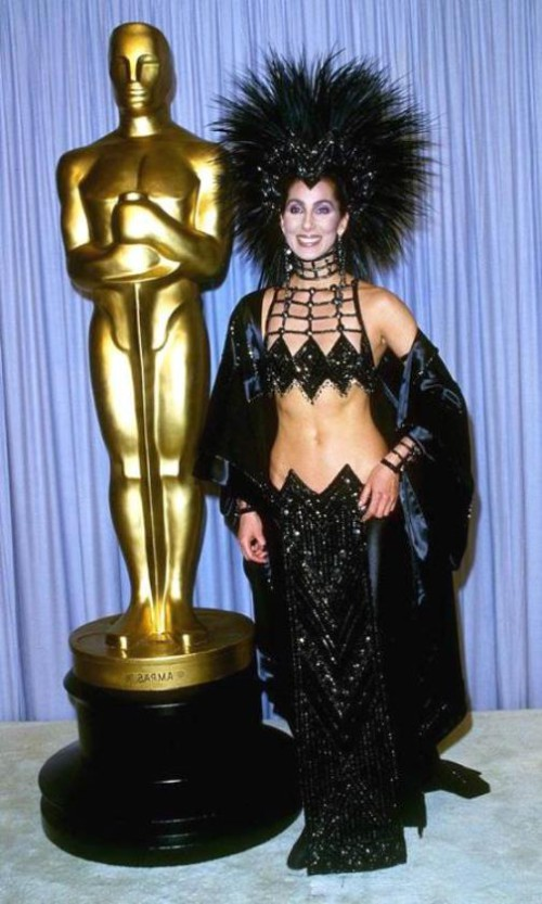 Cher, 1986. Dress for dancers from Vegas and headdress similar to cock head ... from Bob Mackie