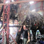 Giant sculpture of an elephant made from recycled metal. Next to it its creator talented sculptor Tom Samui