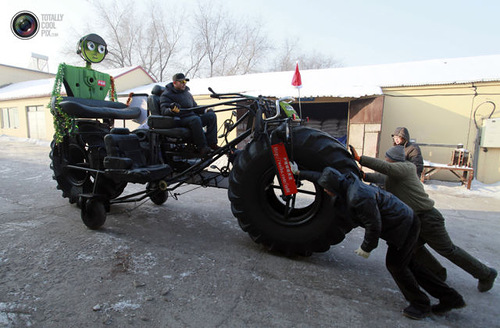 Weird Inventions Made by the Chinese. Zhang Yali, 49, tests a giant bicycle designed and made by him and his friends