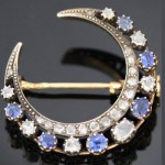 Moon brooch with sapphire