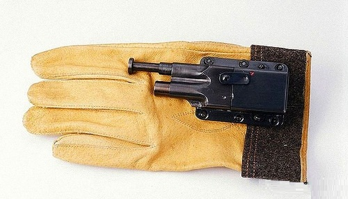 Glove Pistol. Circa 1942-1945, U.S. Navy (ONI) Armed with a glove pistol, an operative still had both hands free. To fire the pistol, the wearer pushed the plunger into an attacker's body.