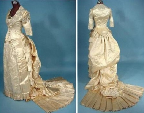 Wedding dress of cream silk satin, decorated with beads. End 1870 - beginning of the 1880s