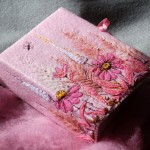Book cover with pink flowers. Thread art by Latvian artist of applied art Indra