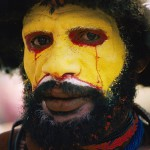 Tribal man painted his face in Yellow