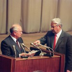 Russian President Boris Yeltsin gestures towards Soviet President Mikhail Gorbachev in Moscow on August 23, 1991 while he enjoins him to read a paper during session of Russian Parlement
