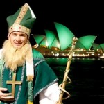 A man dressed as St Patrick poses for pictures as Sydney Opera House is lit with green lights during celebrations in central Sydney March 17, 2010