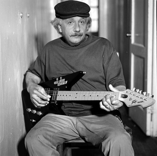 Albert Einstein playing the guitar