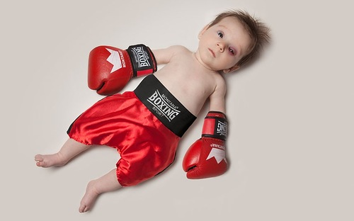 Baby June dressed as a boxer. Photo project by American photo artist Eric Maloberti