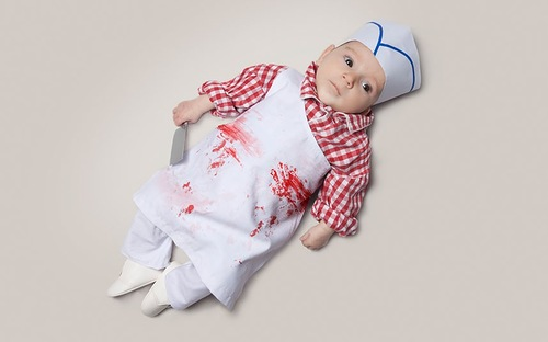 Baby June dressed as a butcher. Photo project by American photo artist Eric Maloberti
