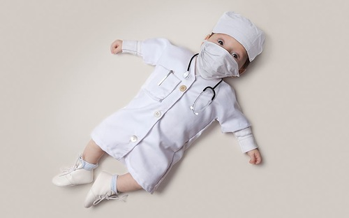 Baby June dressed as a doctor. Photo project by American photo artist Eric Maloberti