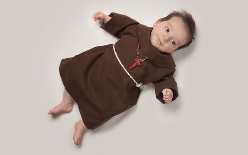 Baby June dressed as a monk. Photo project by American photo artist Eric Maloberti
