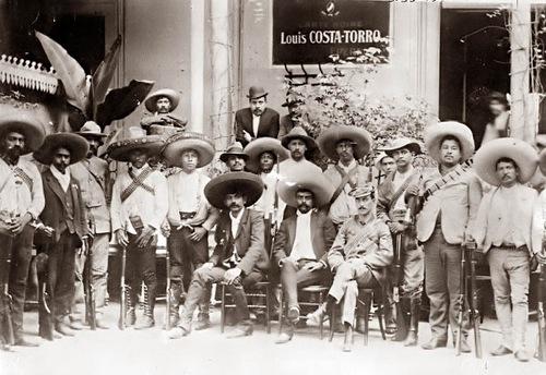 Emiliano Zapata (sitting, center)