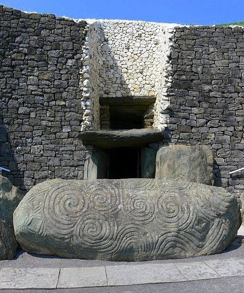 Newgrange older than Stonehenge and pyramids of Giza. UNESCO World Heritage Site Newgrange. Entrance stone with megalithic art