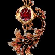 Gold Fish pendant brooch. Yellow sapphires, diamonds, light and dark orange sapphires, yellow gold