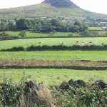 """Slemish mountain County Antrim – the reputed burial place of St. Patrick in Downpatrick. And the saying – """"If you dig a grave for others, you might fall into it yourself"""""""