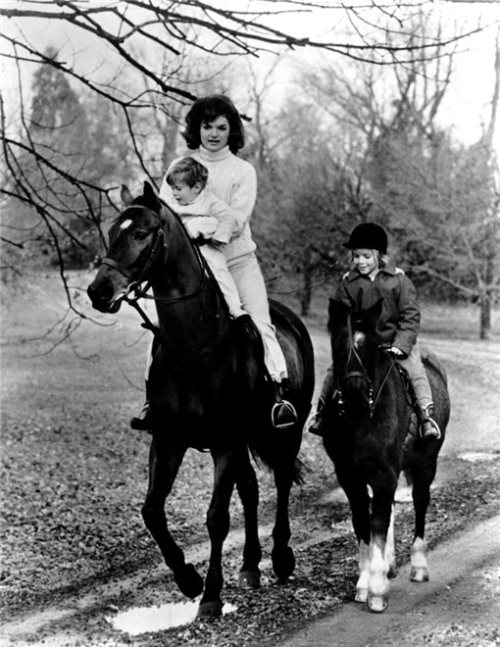 Jackie with children, horse riding