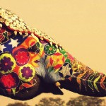 An elephant decorated with colorful drawings