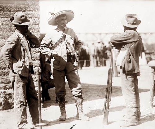 Maximo Castillo (center with pen on the hat)