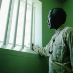 Nelson Mandela in his confinement cell where he had been incarcerated for twenty seven years for his views in opposition fo the apartheid regime