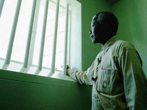 Nelson Mandela in his confinement cell where he had been incarcerated for twenty seven years for his views in opposition to the apartheid regime