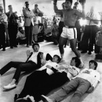 Posing with the world heavyweight title contender Cassius Clay, better known as Muhammad Ali, during a visit to one of his training sessions in Miami