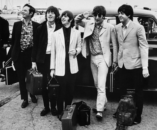 The Beatles with their manager, Brian Epstein, arriving in London where they are welcomed by a crowd of two hundred fans