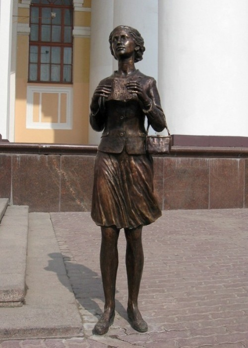 The sculpture, which is installed on the pavement Theater Square, a girl asking for an extra ticket