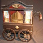 Toy barrel organ, Sankyo, ca 1980. Plays melodies stored on a paper strip