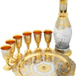 Brandy Gift Set 'Spring'. Handmade. Brass, crystal, artificial stones – phianites. Engraving, etching, nickel plating, gold plating, cutting metal. The set consists of a decanter, 6 glasses and dishes