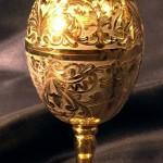 Golden engraved Easter egg. Zlatoust art of steel engraving